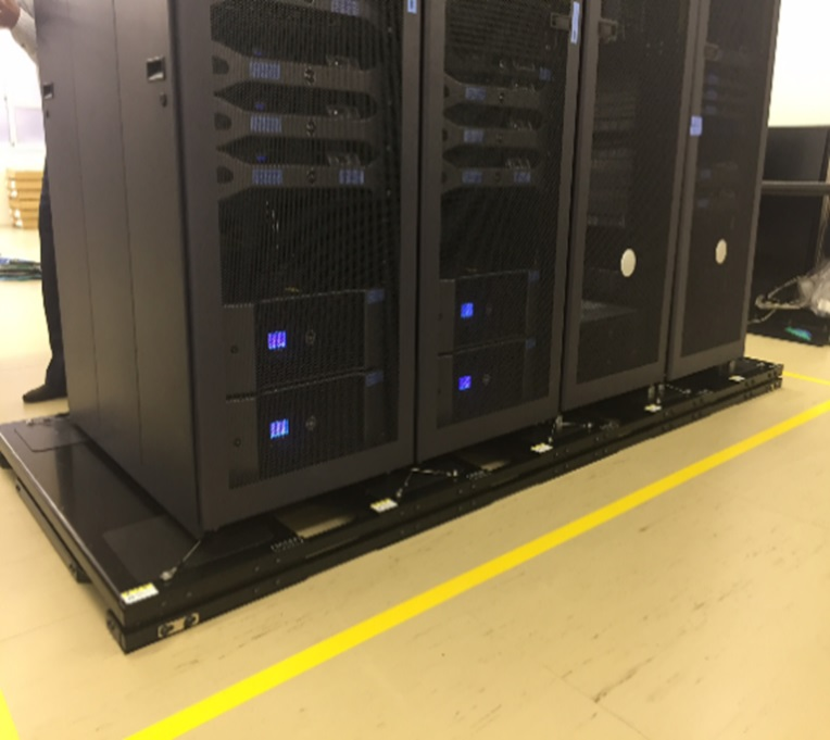 Installation of a seismic base isolator in the server room